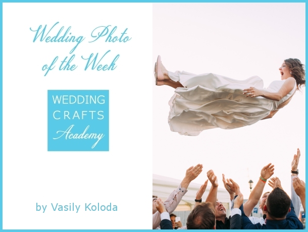 Wedding Photo of The Week - Bride being thrown into air by wedding guests