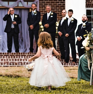 wedding photo - flower girl and groomsmen
